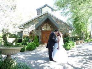 The-Chapel-Bride-and-Groom-Kissing-in-Front-of-The-Chapel